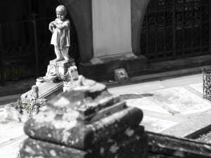 child statue in graveyard